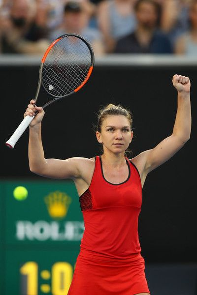 Simona Halep Photos - Simona Halep of Romania celebrates winning her second round match against Eugenie Bouchard of Canada on day four of the 2018 Australian Open at Melbourne Park on January 18, 2018 in Melbourne, Australia. - 2018 Australian Open - Day 4