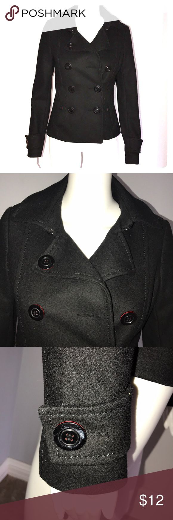 Divided Black Pea Coat Shell - 60% Wool, 30% Viscose, 10% Polyester  Lining - 100% Polyester Buttons have a thin red outline Comes with extra buttons Super cute!! Divided Jackets & Coats Pea Coats
