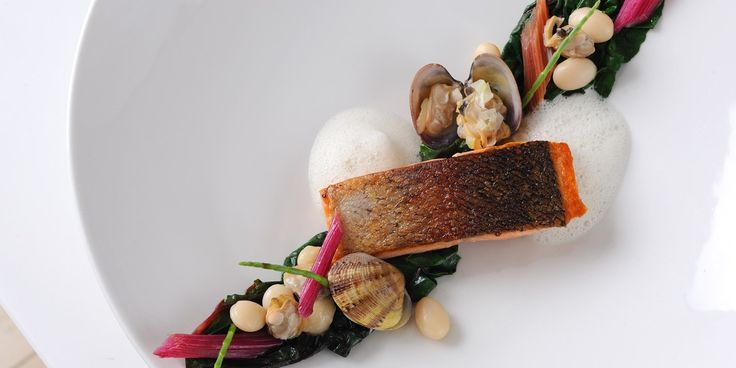 Top chef Alan Murchison creates an elegant sea trout recipe using prime produce from the British coast. Sea trout, clams, ruby chard and samphire all feature