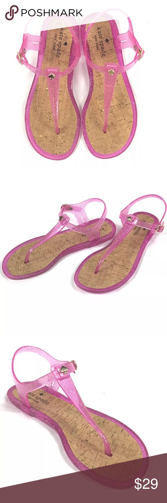 Kate Spade Yari Pink Glitter Jelly Sandals Kate Spade Yari Pink Glitter Jelly Sandals. Women's Size 6. Worn one time, logo is slight rubbed off on right sandal. Rubber . Rubber sole. Flat jelly sandal featuring T-strap thong with spade logo at cross-strap. Cork-covered footbed. Adjustable buckle at ankle. kate spade Shoes Sandals