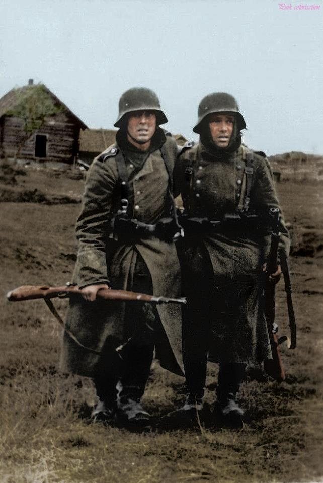 Two weary German soldiers on the Eastern Front, 1942, Russia. The fear and fatigue on their faces is clearly visible.