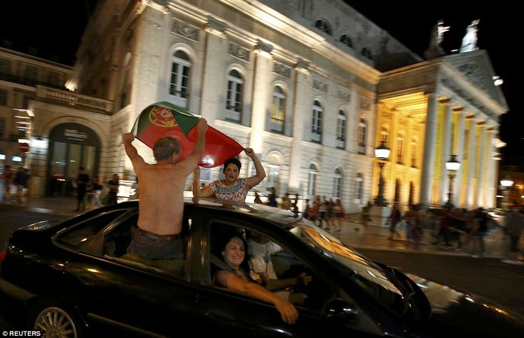More fans waving flags out of cars, this time in Lisbon after Eder's strike sealed the Eur...