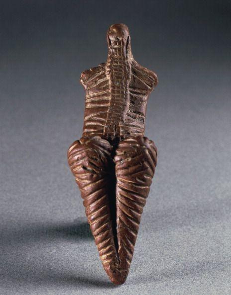 Prehistory Romania Neolithic Cucuteni culture Decorated terracotta statuette of female figure