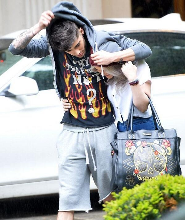 He's covering her from the rain, IT'S SO FREAKING ADORABLE!! STOP MESSING WITH MY FEELINGS!!!!!!