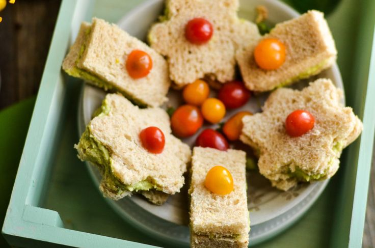Need a simple yet fancy Easter party food idea? Try this recipe for Avocado Egg Salad Finger Sandwiches. Traditional egg salad just got a festive and healthier spring makeover!
