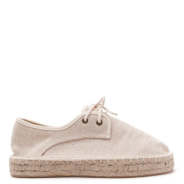 Nude-coloured fabric espadrilles with laces and rope-covered rubber double sole.