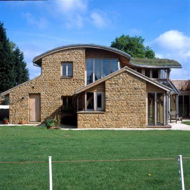 Roderick James Architects - mix of Cotswold stone, oak, glass and green roof