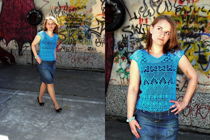 Turquoise crochet blouse with short sleeves.