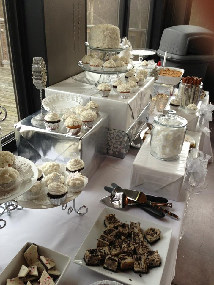 I like the silver and white theme and boxes wrapped in paper as part of the dessert table display. All white/textured cake is really cute too!