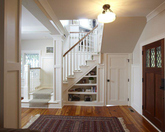 amusing-staircase-designs-for-small-spaces-white-shelving-under-stairs-hanging-bulb-lamp-area-rug-laminated-wooden-floor-wooden-entry-door