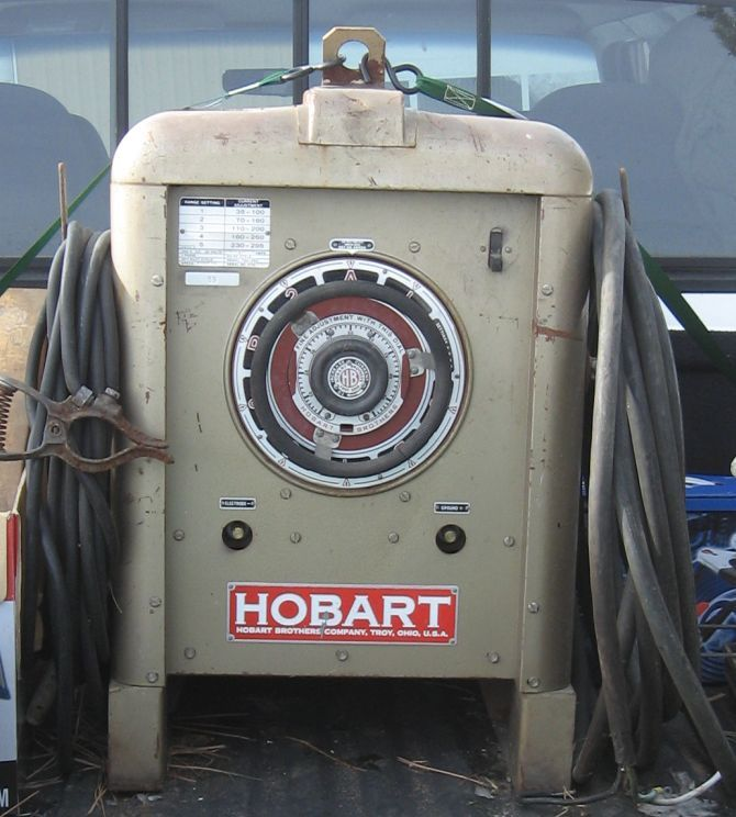 Hobart Welder, with a rounded stamped case and large inviting handwheel. Proudly made in USA by guys wearing crewcuts.