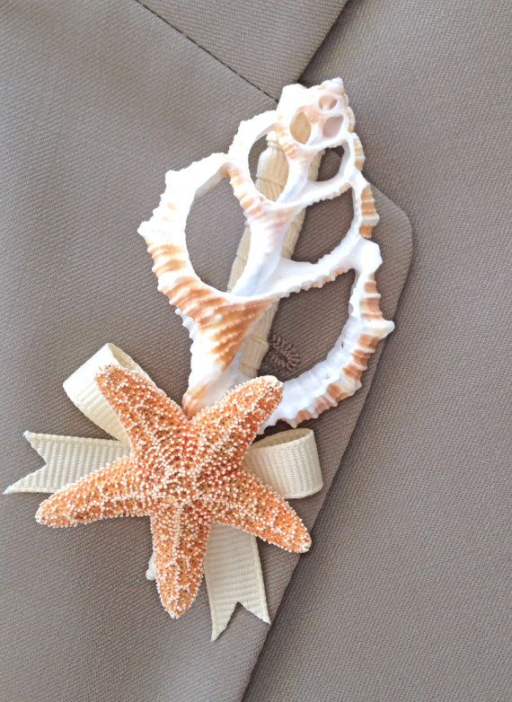 This real seashell boutonniere is ideal for beach weddings or beach events.  What man wouldnt like this? Nothing frilly or fussy, just simple
