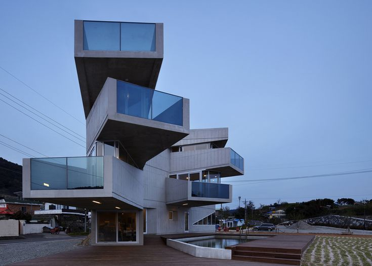 Aggrenad Hotel by AND    Korean architects AND imagined this hotel on Geoje Island as a hand of outstretched fingers, with rooms and balconies pointing out in different directions. Containing just five suites and a cafe, the small concrete hotel sits beside the seafront in the small fishing village and was designed to give each guest a different view of the surrounding archipelago.