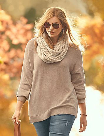 Zippered sides add just the right pop of contrast to our easy-wearing pullover sweater. Cozy, medium-weight knit sweater features classic ribbed cuffs, hem and scoop neckline, with wide ribbing down the center of the back for a modern touch. lanebryant.com