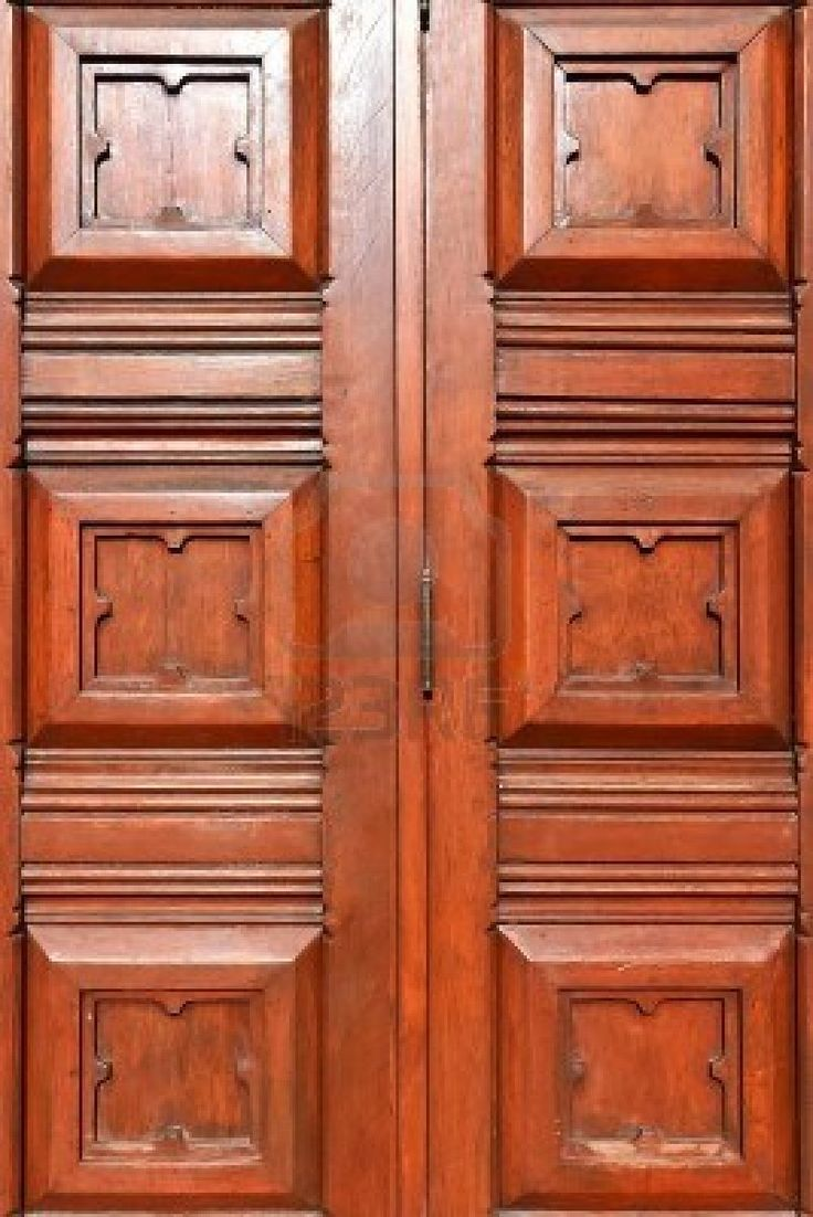 Close up of traditional carved wood on church main for Traditional main door design