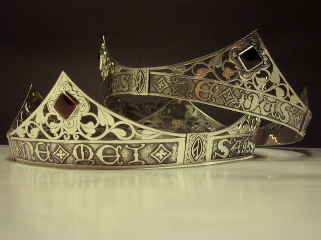 """Daniel de Blare and Aeschine Colquhoun Viscounty Coronets - Made with a nitric acid etching (lettering) by Diane de Winchester and hand pierced foliated scrollwork by Mark von dem Falkensfenn. The black and red square """"stones"""" are enamels with gold foil beneath."""