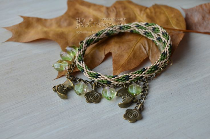 Green and bronze Japanese kumihimo braided cord bracelet with glass beads #kumihimo #braidedbracelet #beadedbracelet #wovenbracelet #green #baige #charmbracelet #cordbracelet #ropebracelet #threadbracelet #rainbowayjewelry