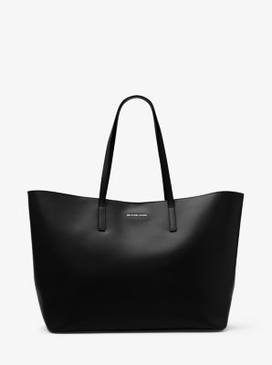 With its spacious silhouette and super-sleek leather craftsmanship, our Emry…