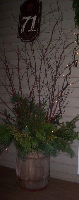 primitive touch Christmas Porch Decorations via HGTV