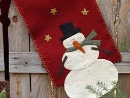 Table runner. Love the red with a snowman.