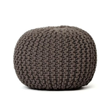 This Knitted Pouf is one of the best pieces I picked up for my living space.  Since our space is compact, its a perfect extra seat without overwhelming the space, or an easy foot prop for relaxing.