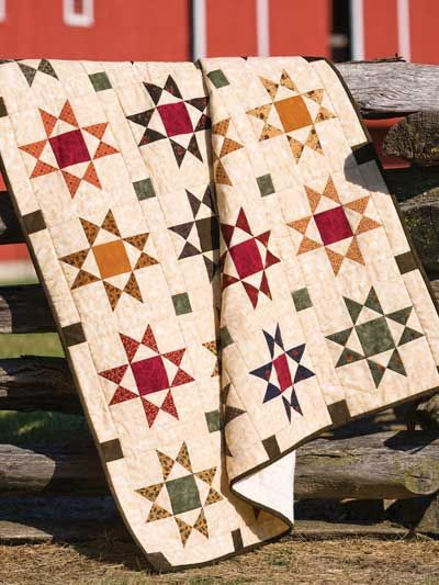 """Charming Ohio Star Throw Quilt Pattern Download from e-PatternsCentral.com -- Using precut 5"""" squares and an easy method to create quarter-square triangles makes this classic quilt quick to stitch."""