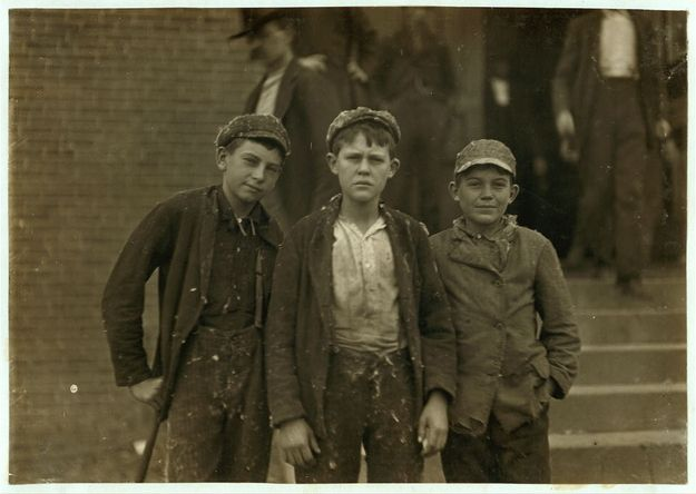 November 1908: Workers on their way home from Loray Mill. The smallest boy on the right end, John Moore, 13 years old, had already been working at the mill for 6 years as sweeper, doffer and spinner. Gastonia, North Carolina - Photo by Lewis Hine, found via Buzzfeed