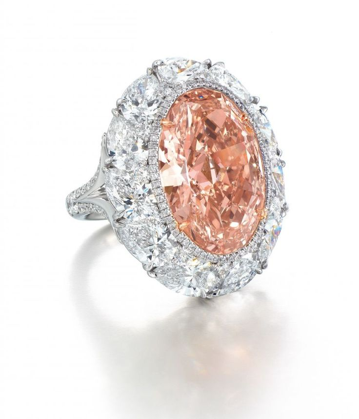 Oval-shape 12.85 ct. fancy intense orangey pink diamond; sale price: $4,950,720—a world record price for an orangey pink diamond, plus a world record price per carat ($385,000) for an orangey pink diamond.
