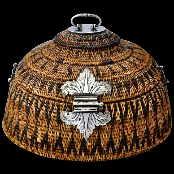 Kandy, Sri Lanka, 18th to 19th century | This cane basket called a vel-pettiya with engraved silver mounts is typical of such baskets produced in the Kingdom of Kandy in central Sri Lanka.  They were made for members of the Kandyan aristocracy and were used to store jewllery and keepsakes.
