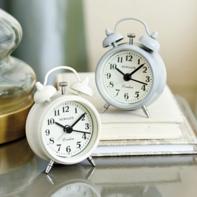 Mini vintage style alarm clock... would be so cute in guest room.