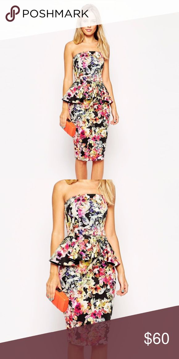 "Asos Dark Floral Bandeau Dress With Peplum Waist Chic & sexy, strapless bandeau dress with vibrant floral print and peplum waist by Asos. Features hidden back zip and hook closure, bandeau top with elastic back, bodice with boning, wrap over peplum waist, back slit. Preloved & in excellent condition. Flat measurements: bust 16-18"" (bust has some stretch); waist 15.5""; length 36"" (top of bust to bottom hem). Please ask any questions or request additional photos prior to purchasing. NO TRADES…"