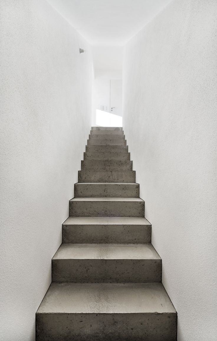 """Concrete at its best! Staircase in the house """"ke 12"""" built by German Soho Architektur Firm in the city of Memmingen."""