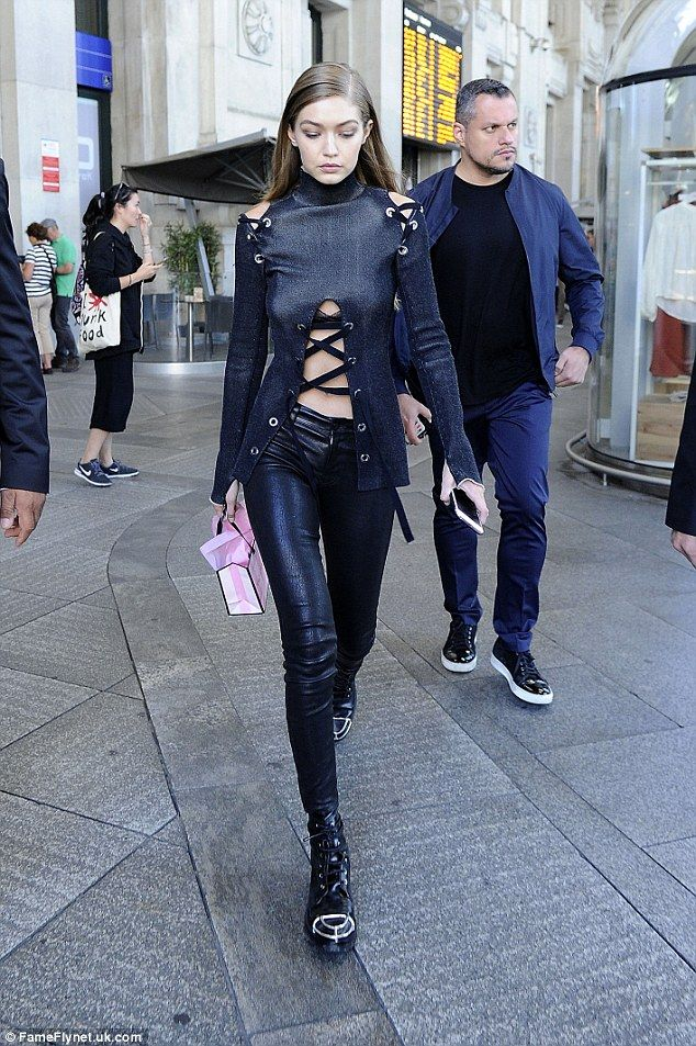 Busy day! Gigi also made time in her day to shop at the Victoria's Secret store in Milan in a risqué cut-out black ensemble