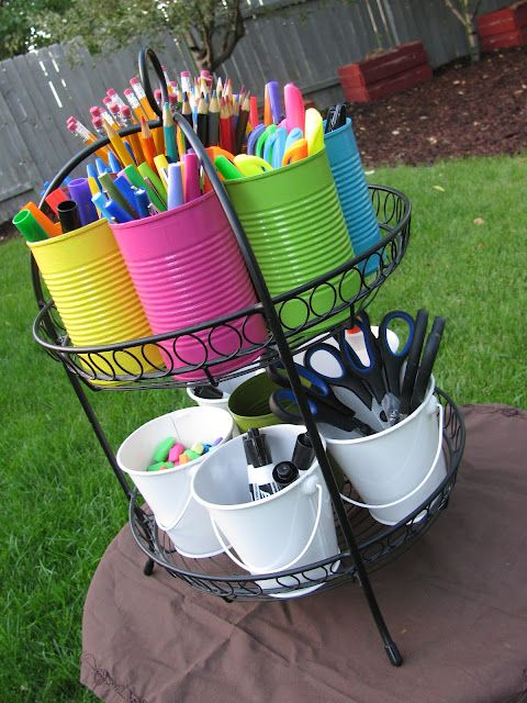 School Supply Caddy ~ how AWESOME!!! Using a serving plate stand or even maybe a plant stand, you paint cans in whatever colors, get buckets and fill with school supplies or art supplies. Kids can use & put back easily. I would go one step further and label each can.