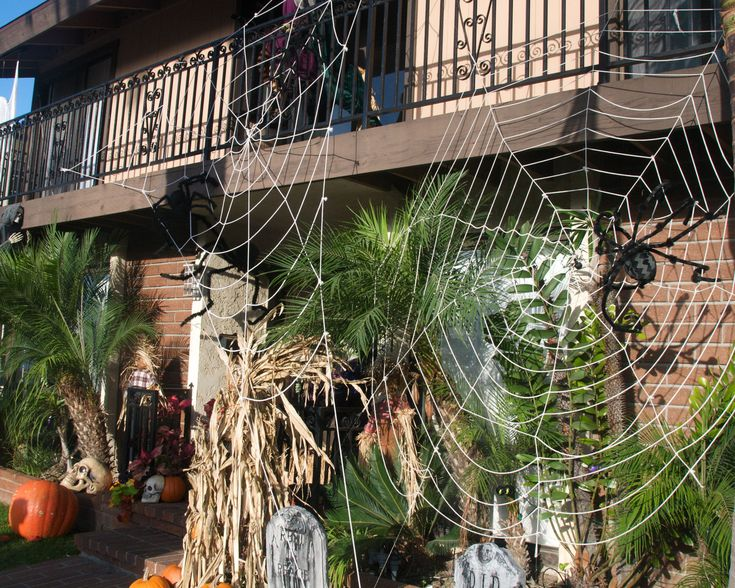 diy impressive great halloween decorating ideas awesome spider web on front yard stunning spider puppet fake skull near ladder also scary gravestone under - Scary Homemade Halloween Yard Decorations