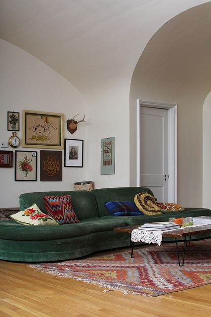 Love the grouping of the furniture, the gallery wall but oh, those vaulted ceilings... wow.