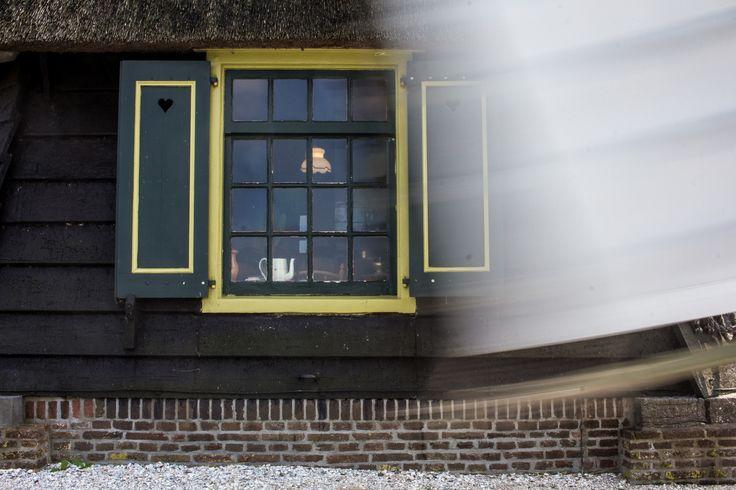 Museummolen, Schermerhorn - Look through the window inside the windmill at Schermerhorn, The Netherlands.