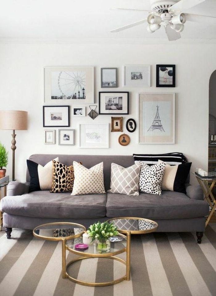 cadre photo personnalisé, table basse dorée, plantes vertes, coussins à motifs panthère, ventilateur blanc