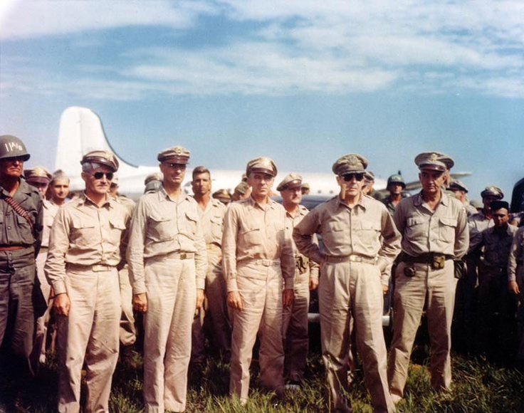 MacArthur arrived at Atsugi airdrome, near Tokyo, Japan, 30 Aug 1945; Maj. Gen. Joseph Swing and Lt. Gen. Richard Sutherland also present