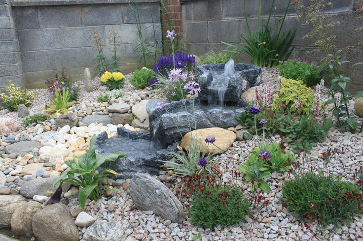 Granite Stream set into a Raised Flower Bed which has been covered with Gravel More on www.mvstone.ie