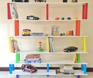 """45 Minute Flat Pack Rainbow Bookshelf - This bookshelf is approximately 5 feet high, 6 feet long and 9"""" wide.What's great about this shelf is it's  super easy to do, looks great visually and packs up flat to an area of 6""""x9""""x72""""! Even this could be made to  disappear when you spread out the shelves... 