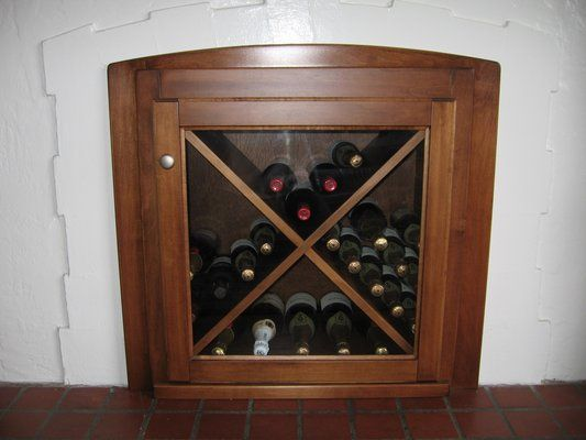 wine racks in fireplace | Unused fireplace converted to built-in wine rack. | Yelp