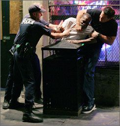 Police officers subdue a man later identified as Robert Davis in the French Quarter of New Orleans on Oct. 8, 2005. A former police officer ...