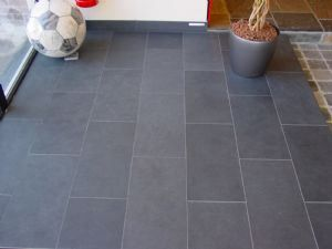 large grey floor tile subway close lay with dark grey grout maybe in the guest bathroom