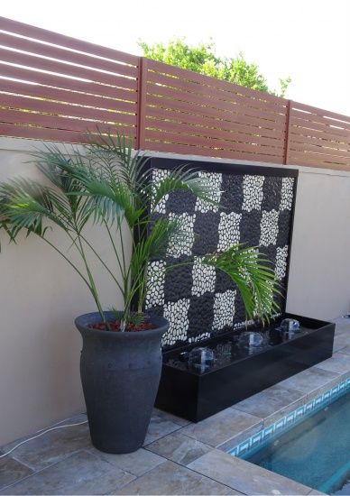 Pebble Water Feature- Checkers Reminiscent of a checker board this water feature is unique and visually striking.