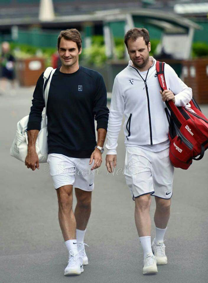 (Roger Federer and coach) At a quick glance at this photo I thought they were holding hands lol