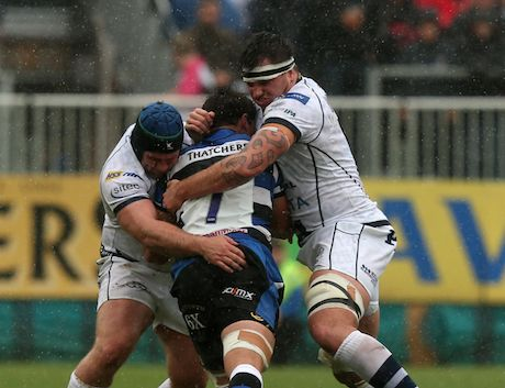 Glen Townson and Bruce Douglas combine to make a tackle in the pouring rain