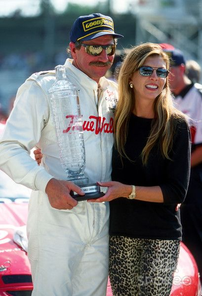 Dale Earnhardt Sr and wife Teresa Earnhardt pose for pictures.