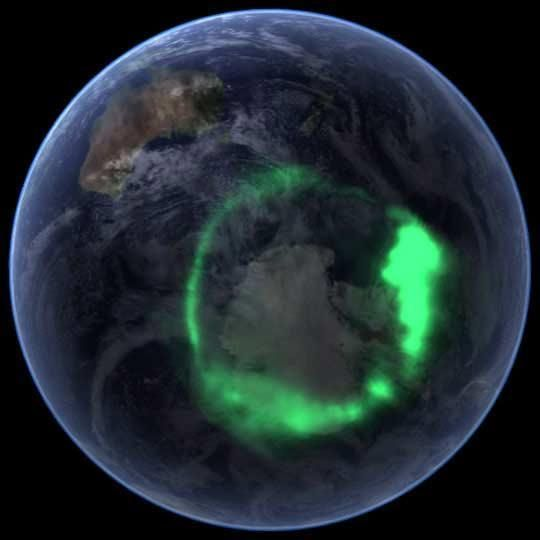 NASA's IMAGE satellite captured this view of the aurora australis (southern lights) on Sept. 11, 2005, four days after a record-setting solar flare sent plasma — an ionized gas of protons and electrons — flying towards the Earth.    The ring of light that the solar storm generated over Antarctica glows green in the ultraviolet part of the spectrum, shown in this image. From the Earth's surface, the ring would appear as a curtain of light shimmering across the night sk: Southern Lights, September 11, Trav'Lin Lights, Northern Lights, Aurora Lights, Aurora Borealis, Spaces Stations, Solar Flare, Aurora Australia