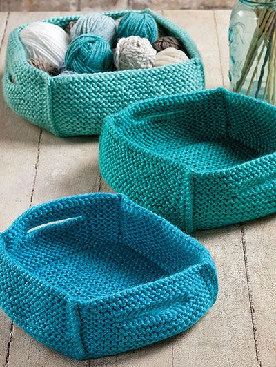 """Nesting baskets to keep everything in its place. You'll love how quick these baskets are to knit, and how useful they are for storing your odds and ends! Knit with a total of 5 skeins of Premier® Yarns Ever Soft at a gauge of 15 sts and 30 rows per 4"""" using U.S. size 10 1/2/6.5mm needles and a size G/6/4mm crochet hook. This pattern was originally published in the autumn 2014 issue of Creative Knitting magazine."""
